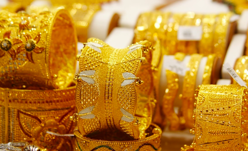 Gold rates fall for 5th day in a row, stands at one-year lows; silver down too