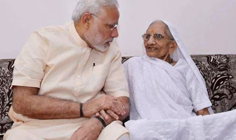 PM Modi's mother Heeraben gets her first shot of COVID-19 vaccine