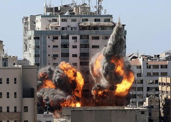 Israel bombs Hamas Gaza chief's home as fighting enters 7th day