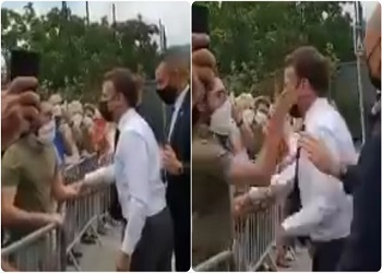 On camera, French President Macron slapped in face during walkabout, 2 Arrested
