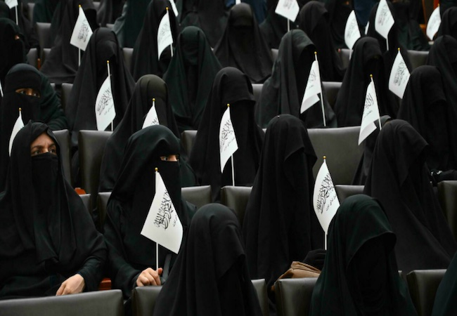 Veiled Afghan women rally in support of the Taliban